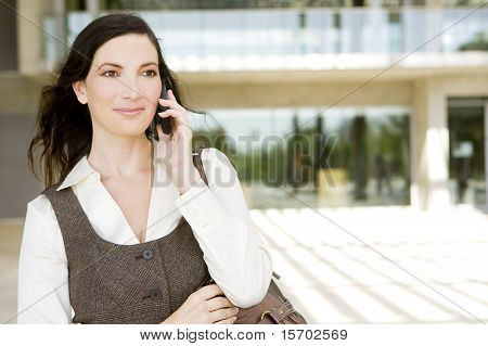 Professional young business woman outside her office