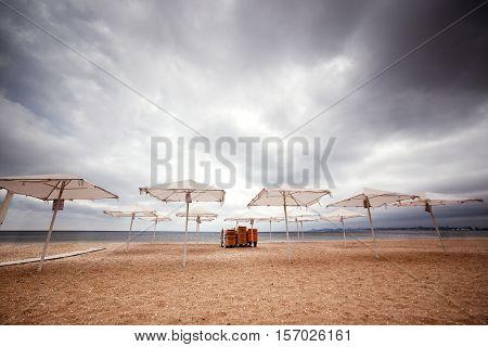 Sun umbrellas on the beach. Seaview. overcast.
