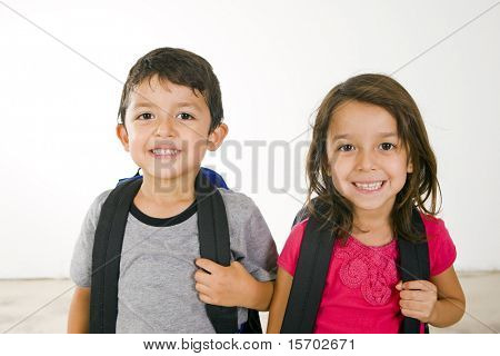 Little boy and girl with their book bags