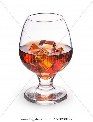 whiskey cognac with ice cubes in a glass isolated on white background