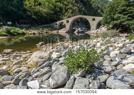 Amazing Reflection of The Devil's Bridge in Arda river and Rhodopes mountain, Kardzhali Region, Bulgaria