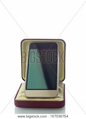 Mobile phone in box with a shadow on a white background.