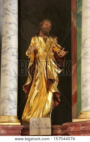 KRASIC, CROATIA - MAY 15: Saint Matthew statue on the altar Adoration of Magi in parish church of the Holy Trinity in Krasic, Croatia on May 15, 2012