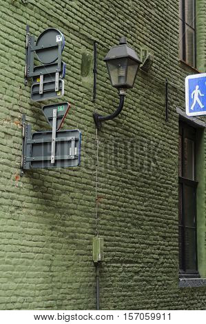 Narrow street alley with green brick wall in Gent, Belgium