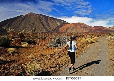 Woman running. Trail running on the Volcano Teide, Tenerife