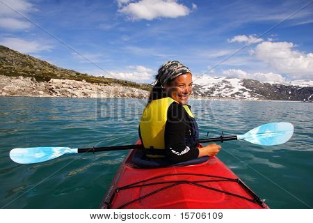 Kayak at glacier lake, Styggevatnet, Jostedalsbreen in Norway.Summer.