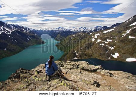 Hiker taking a rest at the spectacular Bessegen view in Norway