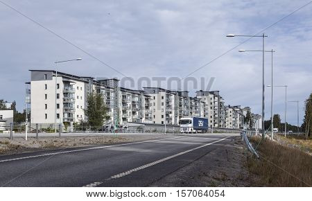 UMEA, SWEDEN ON AUGUST 30. View of a modern suburban settlement, buildings, European highway, traffic on August 30, 2016 in Umea, Sweden. Editorial use.