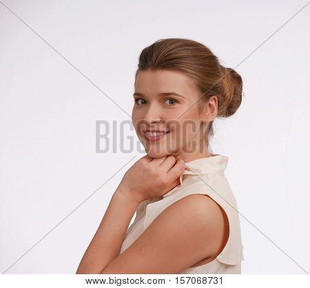 Emotion - happynes. Girl's head, laughing, on white bacground, light colors on back. Shoulder portrait. Horisontal.