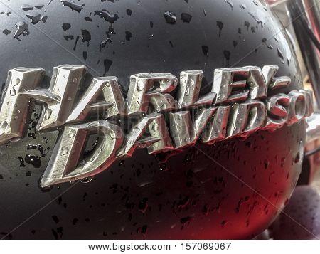Badajoz Spain April 16 2016: Closeup fuel tank of H. Davidson motorcycle full of rain drops