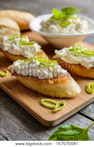 Horseradish And Curd Spread On Fried Egg Baguette