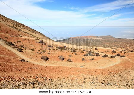 Tenerife Teide landscape. A view of the hiking path at Montana Blanca within the national park showing a lot of the black Teide eggs or in spanish: Los Huevos del Teide.