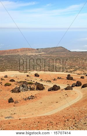 Teide landscape on Tenerife. A view of the hiking path at Montana Blanca within the national park showing a lot of the black Teide eggs or in Spanish: Los Huevos del Teide.