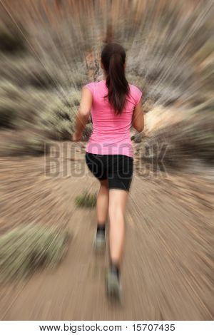Running - woman runner in motion zoom blur for speed effect. Female running outside in desert.