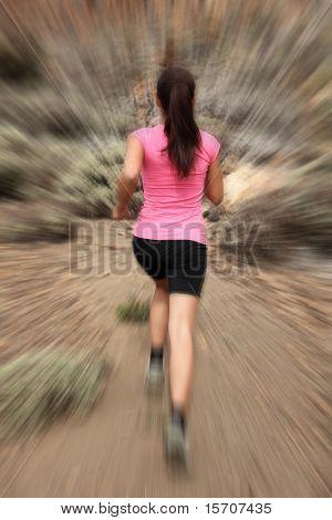 Running - woman runner in motion zoom blur for speed effect. Female running outside in desert.