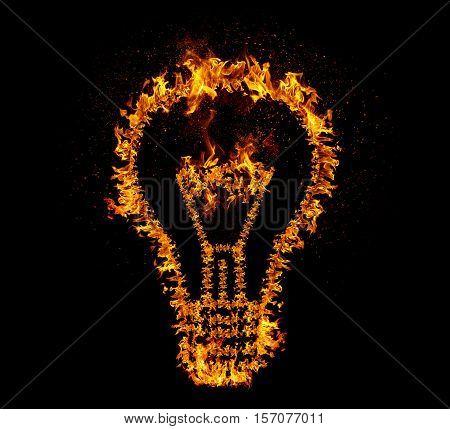 Flaming light bulb isolated on black backgeound. Emergence of the idea Eureka creativity concept.