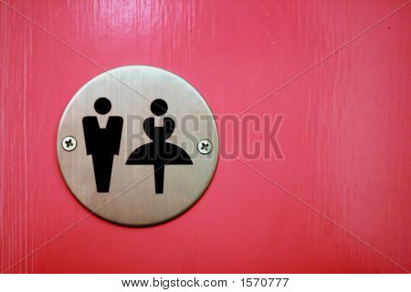Male And Female Bathroom Insignia Against A Pink Background