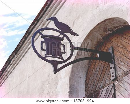 vintage wrought iron advertising sign with the bird on the bracket