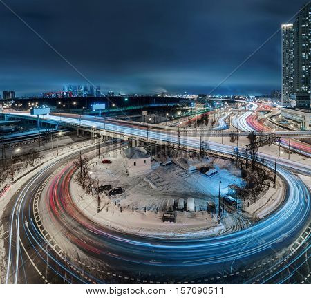 Highway junction and high buildings at winter night in Moscow, long exposure