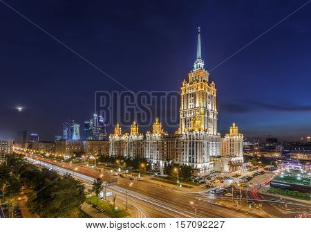 Ukraine hotel with illumination at night in Moscow, Russia, long exposure