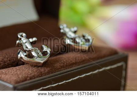 Groom cufflinks shaped anchor on the box