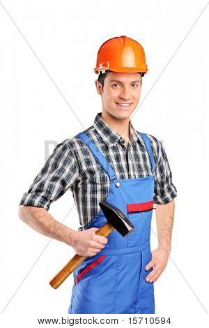 Manual worker wearing blue overall and holding a hammer isolated on white background