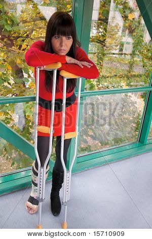 Woman with leg cast and crutches