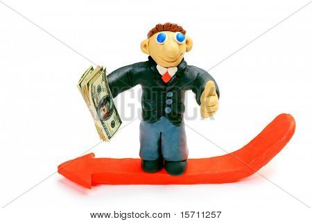 Shot of a plasticine businessman in a suit holding money. Isolated over white background.