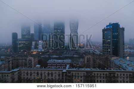 MOSCOW - NOV 5, 2014: Moscow International Business Center in fog. Investments in Moscow International Business Center was approximately 12 billion dollars
