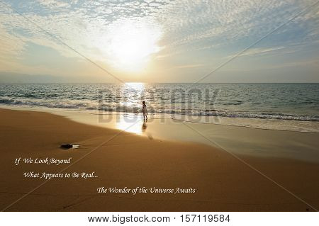 Ocean girl spirit is a young girl on the beach looking at the sun ray burst with awe and wonder.