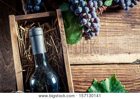 Tasty Red Wine In Wooden Box On Old Wooden Table