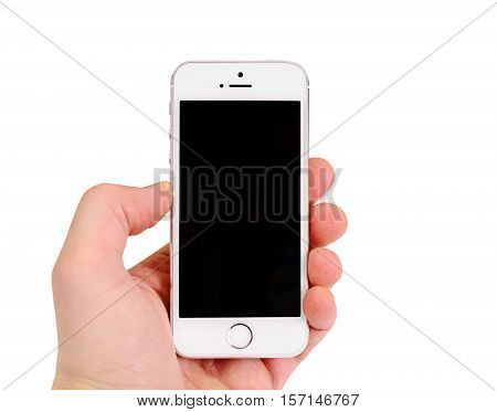 Minsk, Belarus - April 16, 2016: Apple iPhone 5, 5S. White version. The operating system iOS 9. The founders of the company: Steve Jobs, Ronald Wayne, Steve Wozniak. Apple Inc Located in USA