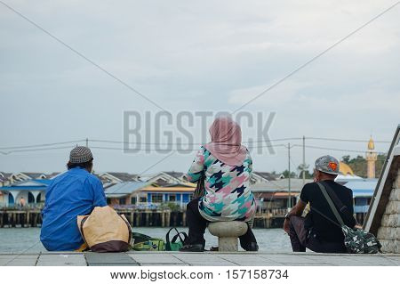 Bandar Seri Begawan,Brunei-Nov 10,2016:Tourists enjoying view of stilt houses of water village at Brunei Darussalam.Bruneians still prefer the lifestyle of the water village to residency on dry land