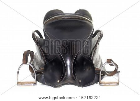 black leather saddle in front of white background