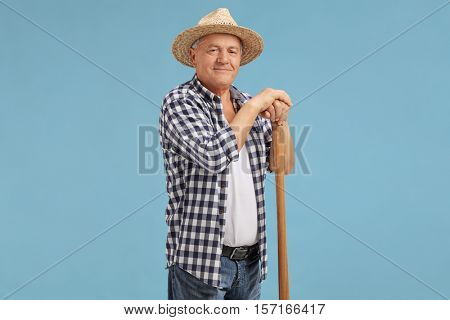 Mature farmer posing on blue background