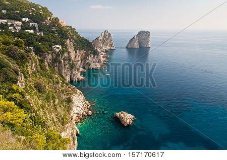 beautiful view of Capri Faraglioni and blue sea