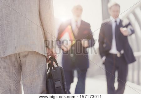 Senior businessmen on the street. Close up on the bag