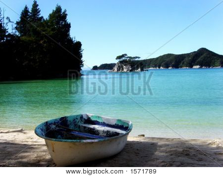 A Boat And Blue Water