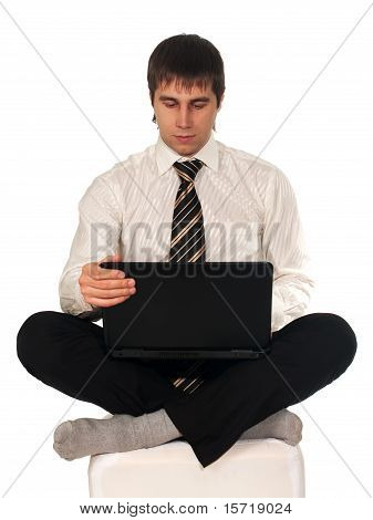 Youing Thoughtful Business Man With Notebook On His Knees