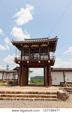 FUKUCHIYAMA JAPAN - JULY 29 2016: Reconstructed Tsuriganemon Gate of Fukuchiyama castle. Castle was erected in 1579 by Akechi Mitsuhide abandoned in 19th c. reconstructed in 1985