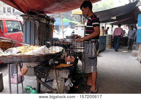 KOLKATA, INDIA - FEBRUARY 10: Street food vendor makes fried snacks in Kolkata, India on February 10, 2016.