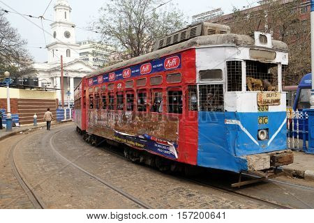 KOLKATA, INDIA - FEBRUARY 10: Traditional tram downtown Kolkata on February 10, 2016. Kolkata is the only Indian city with a tram network, which is operated by the Calcutta Tramways Comp.
