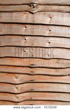 Close Up Of A Wood Slat Fence.