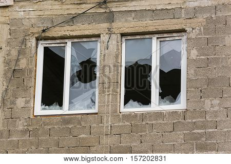 Anapa, Russia - November 16, 2016: Two Windows In An Unfinished House With Broken Windows