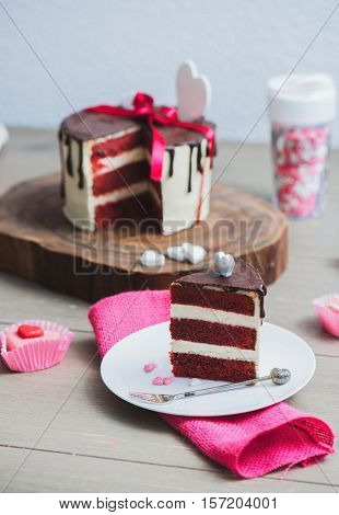 Slice of a red velvet cake with heart shaped decoration