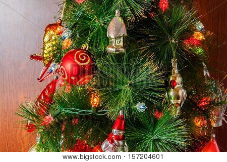 Decorated christmas tree on wooden background. Selective focus