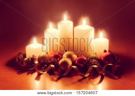 Burning candles with christmas balls. Vintage style