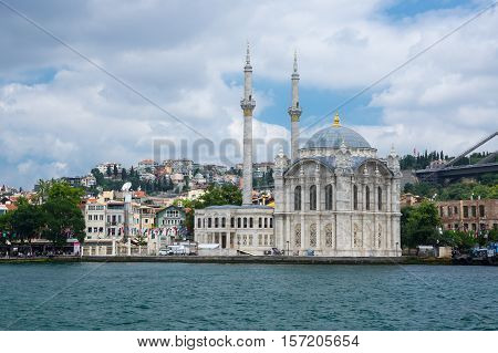 Ortakoy Mosque (Grand Imperial Mosque of Sultan Abdulmecid) in Istanbul Turkey is situated at the waterside of the Ortakoy pier square one of the most popular locations on the Bosphorus