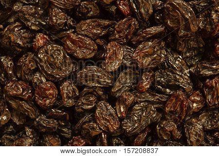 dried black sultana background, pile of raisin photo