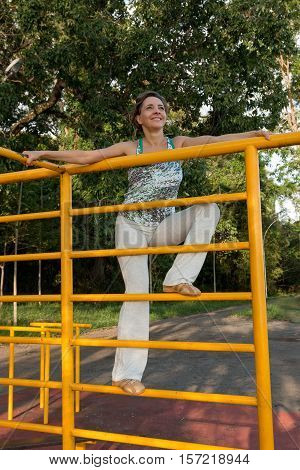 Fit Woman Relaxing on the Fitness Bars